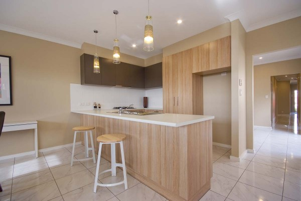 Ashbourne kitchen timber cupboards dark overhead cupboards Villa custom single storey