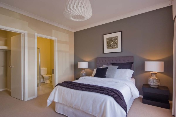 Ashbourne main bedroom ensuite wir feature painted wall custom villa home
